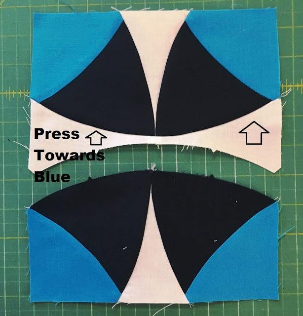press toward blue quilt block pressing