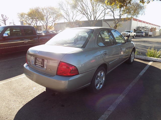 Oxidized paint on 2004 Nissan Sentra before complete paint job at Almost Everything Auto Body.