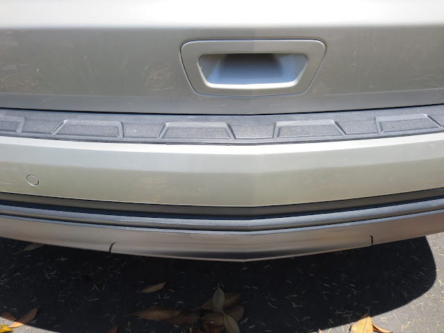 Scrapes on bumper repaired and factory paint re-applied at Almost Everything Auto Body.