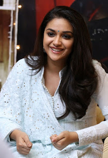 Keerthy Suresh in White Dress with Cute and Awesome Lovely Smile at Mahanati Promotions