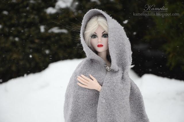 Dolls in winter scenery.