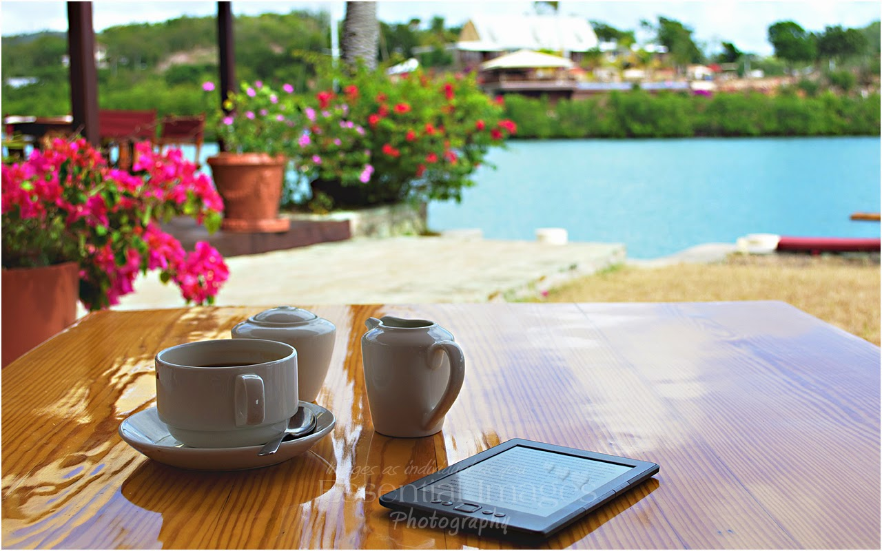Taking coffee at Admiral Inn Antigua and reading kindle
