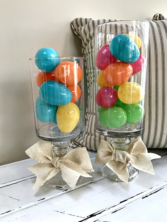 Easter eggs in a tall pedestal vase