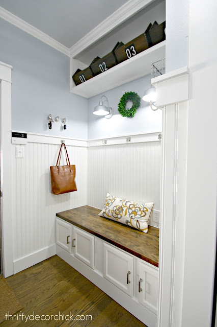 Bright laundry room turned mudroom makeover