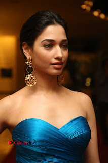 Actress Tamannaah Pictures in Blue Long Dress at Abhinetri Audio Launch  0018