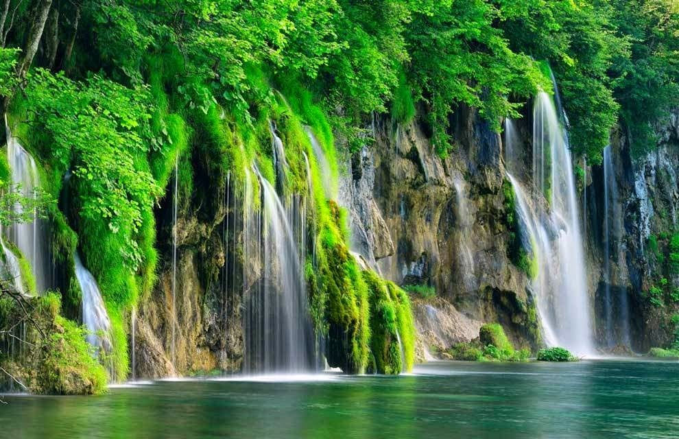 The park is known for its lakes and waterfalls, which are vibrantly blue and cascade majestically through the mountains. There are waterfalls everywhere in Plitvice, and they empty into a series of 16 mountain lakes. - You'd Never Want To Visit This Croatian National Park… It's A Bit Too Beautiful.