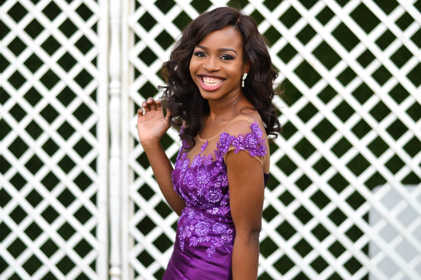 African Bridesmaid smiling in purple dress