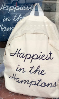 "Backpack with ""Happiest in the Hamptons"" written on it"