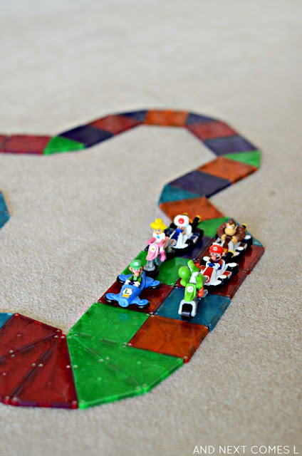 Building a rainbow road out of Magna-Tiles, inspired by the game Mario Kart from And Next Comes L