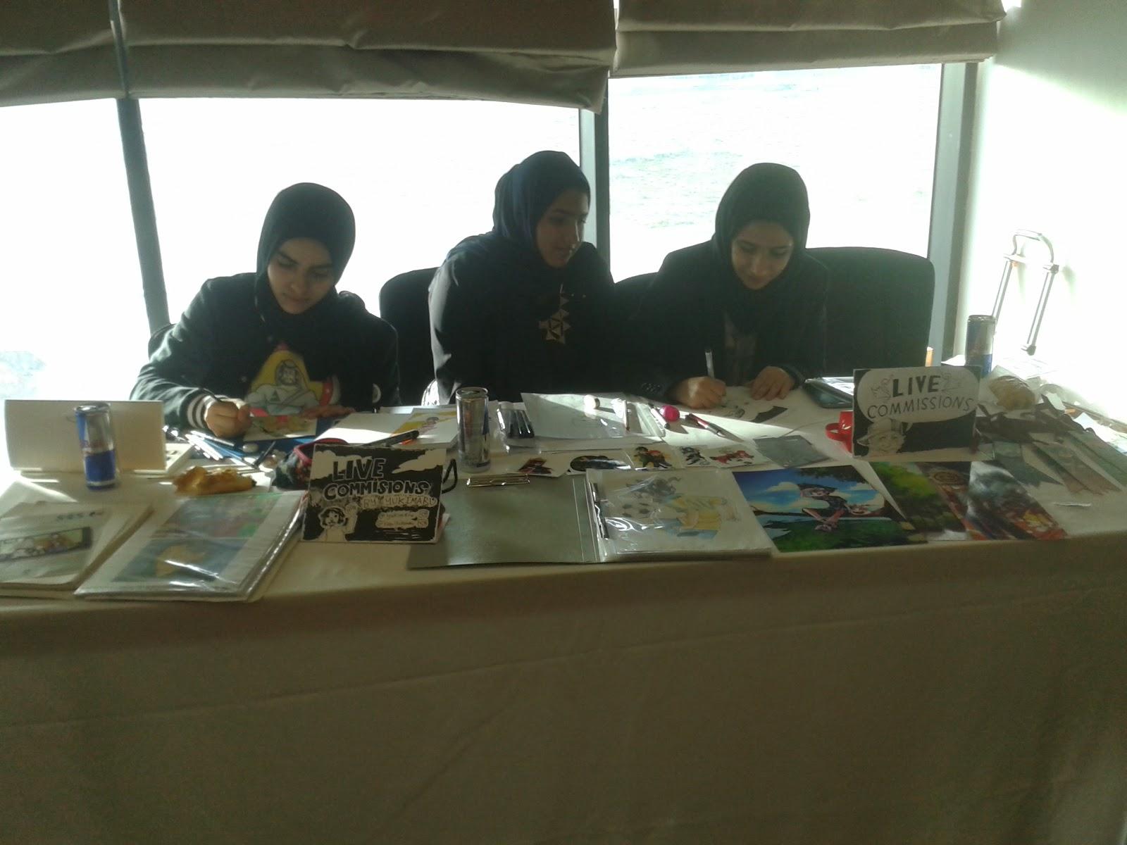 ComiX Bahrain women drawing blogging