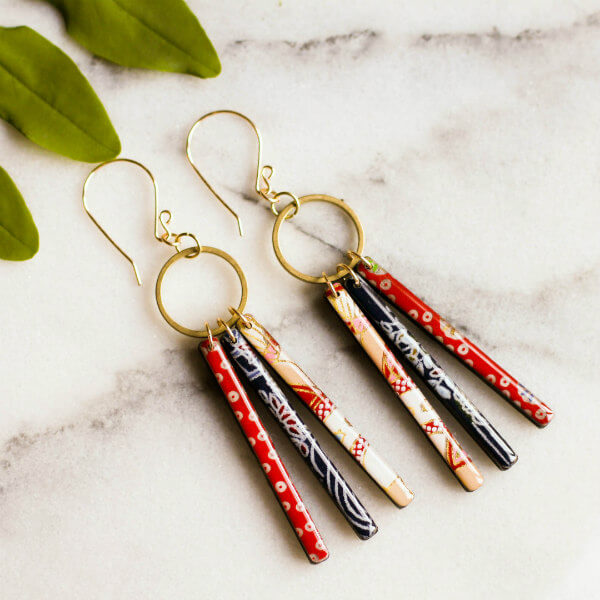 trio of red, white, and blue japanese paper rod and resin drop earrings on brass circles