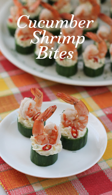 Food Lust People Love: Cheesy cucumber shrimp bites are a quick and easy cocktail party appetizer of fresh cucumber cups filled with spicy cheese and topped with beautiful boiled shrimp, their tails festively aloft.