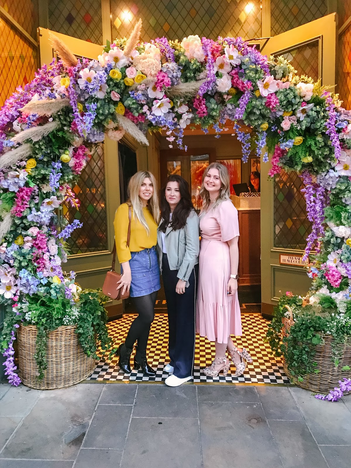 Bloggers at Winchester Fashion Week Launch Party with The Ivy floral entrance