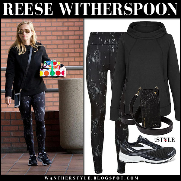 Reese Witherspoon in black hoodie sweaty betty, black printed leggings sweaty betty and sneakers brooks street style january 27