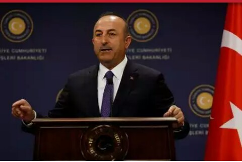 Turkish Foreign Minister Mevlut Cavusoglu gestures during a news conference in Ankara, Turkey