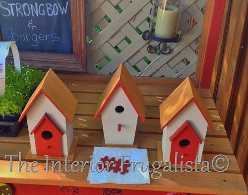 Wood birdhouses used as post caps on garden screen