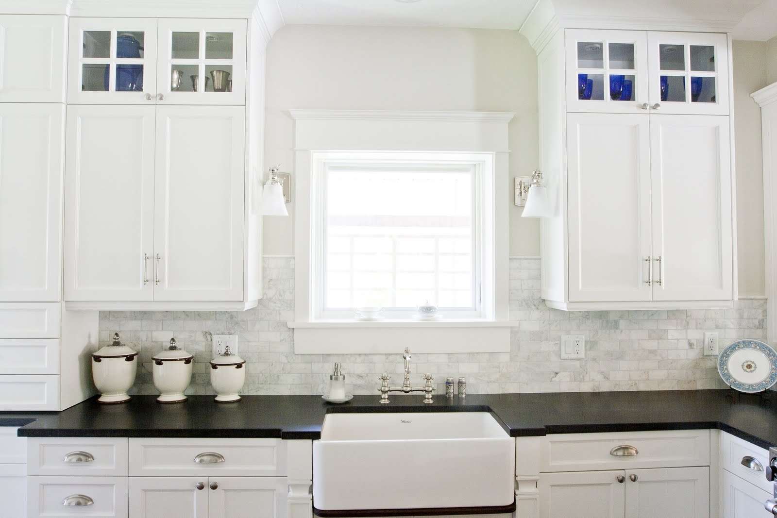 white kitchen cabinets and white sink 8