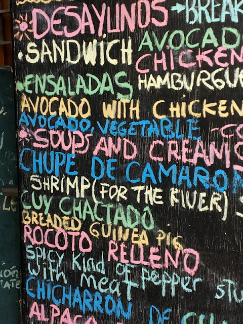 menu board outside a cafe serving guinea pig in Arequipa, Peru