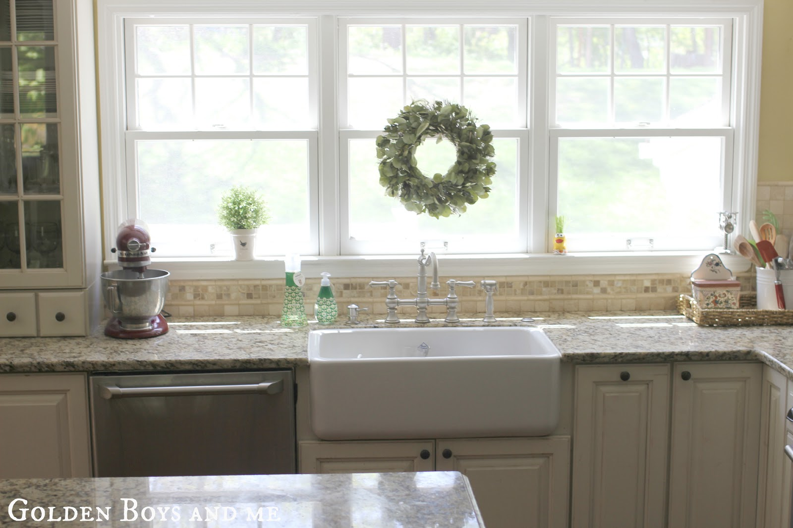 a tour of our kitchen farm kitchen sink DIY kitchen with white cabinets and cherry island with Shaw s farm sink via www goldenboysandme