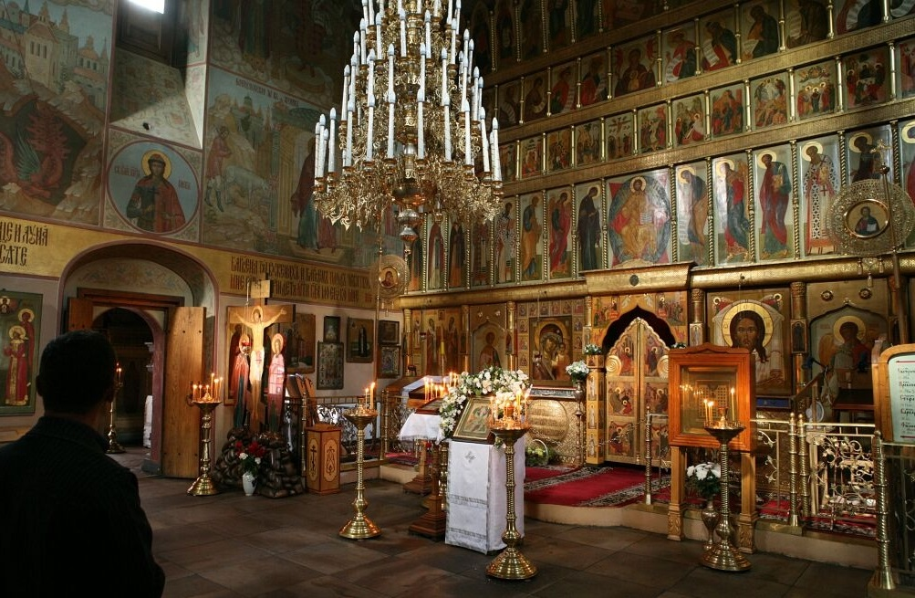 What Is The Significance Of The Iconostasis And Curtain In The