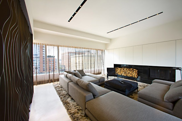 Photo of black curvy wall in the living room of one of the modern New York penthouses