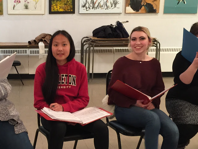 Katie and Suzannah smile for the camera at choir rehearsal