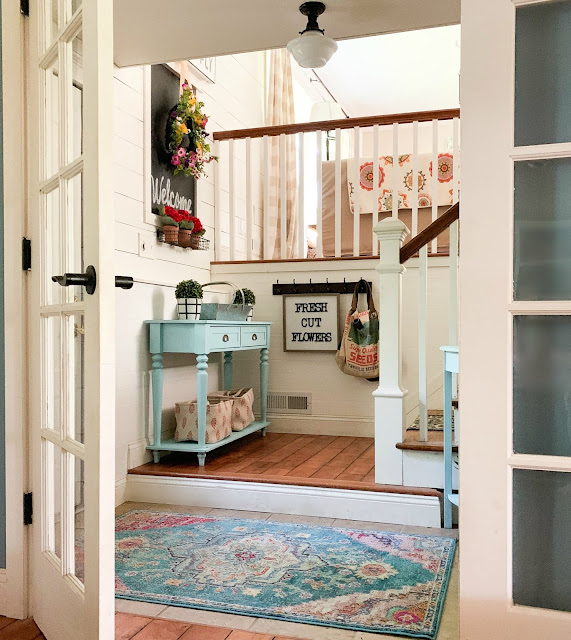 Entryway with colorful cottage style decor - goldenboysandme.com