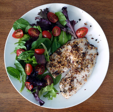 smoked almond crusted tilapia with cherry tomato mesclun salad