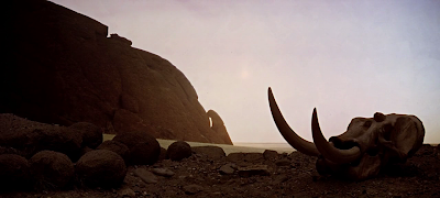 The Dawn of Man, Arid landscape inhabited by ape-like hominids, 2001: A space Odyssey (1968), directed by Stanley Kubrick