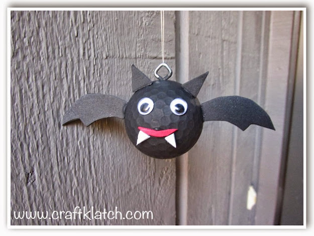 Bat decoration for halloween made out of a recycled golf ball