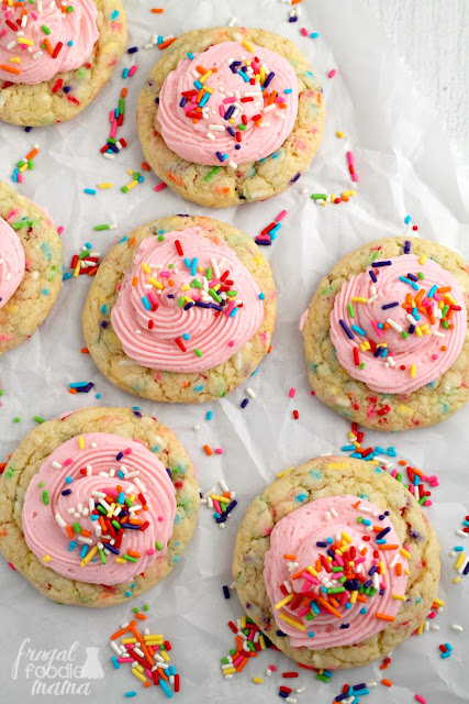 Soft & thick cake mix cookies are loaded up with rainbow sprinkles & then topped with a perfect buttercream frosting in these Rainbow Sprinkle-fetti Cookies.