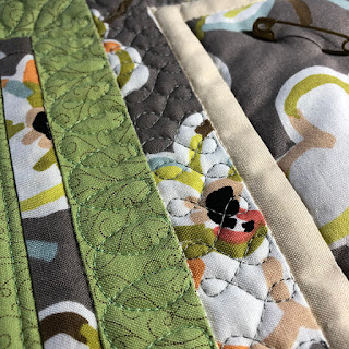 machine quilting on table topper with bird quilt blocks
