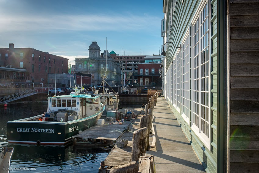 Portland, Maine USA April 2016 photo by Corey Templeton. Looking down the west side of Maine Wharf. The fancy new restaurant Scales is located on the right.
