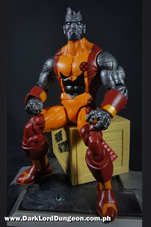 Marvel Legends Colossus sitting on a Yellow Crate