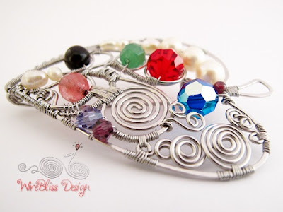 Wire wrapped leaf brooch with multi colored gemstones