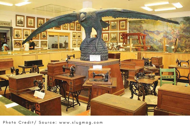 large eagle statue over vintage sewing machines