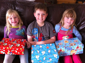 Children with shoebox gifts they packed