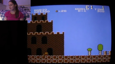 [Image: A screen showing Super Mario Bros., and a smaller picture with Oona in it.]