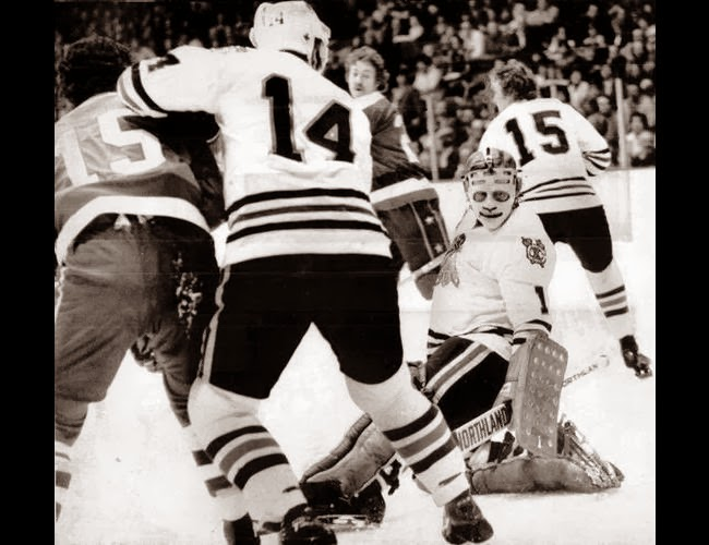 Guy Charron (15) and Tony White (background) both scored in a 4-4 tie (2/9/77)