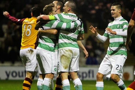 Kris Commons celebrates with Celtic teammates after scoring the opening goal against Motherwell