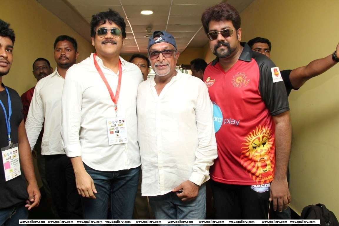Nagarjuna and Nassar pose for photographers during the Natchathira cricket tournament