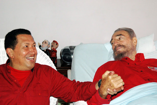 Image Attribute: Venezuelan President Hugo Chavez (L) visits his then Cuban counterpart Fidel Castro in Havana in this August 13, 2006 file photo. REUTERS/Estudios Revolucion-Granma/Handout/File Photo