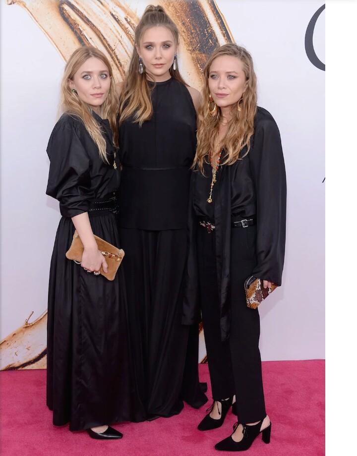Elizabeth-Olsen-Mary-Kate-Olsen-and-Ashley-Olsen (with her sisters)