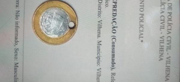 Jovem acaba preso por furar moeda de um real para fazer pingente de colar