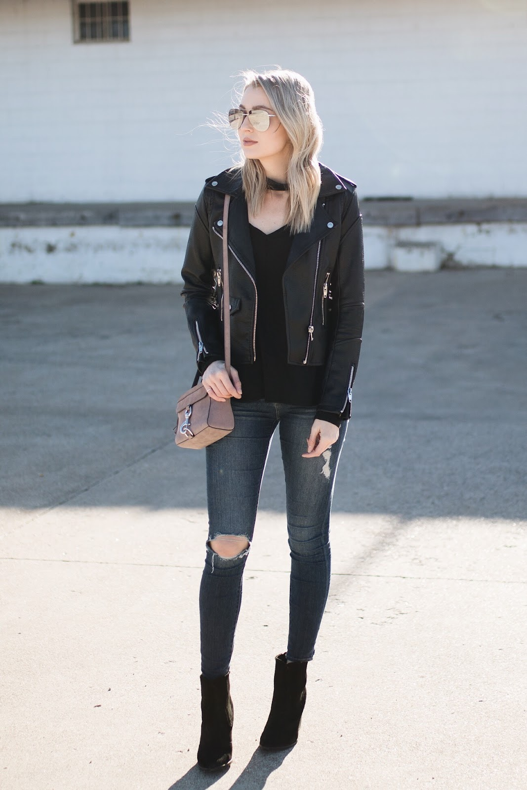 Faux leather jacket with distressed jeans