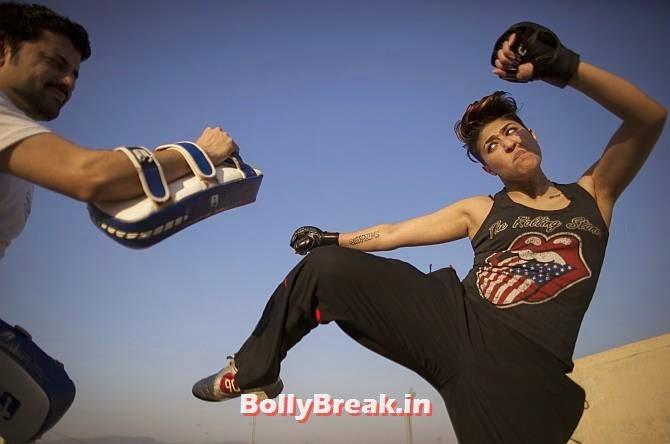 Interior designer Zahra Afridi kicks a punching bag during a kickboxing training session at her home in Islamabad, You will love these Pakistani Bold Women of 2014