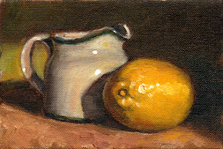 Oil painting of a lemon beside a small white porcelain milk jug.