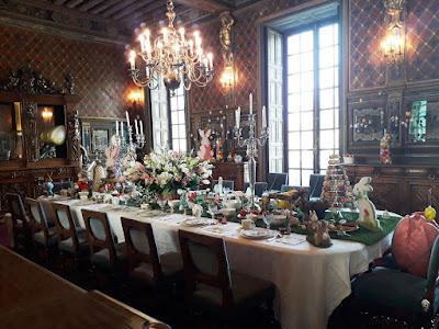 inside Chateau de Cheverny at Easter with the dinning room table set for the season