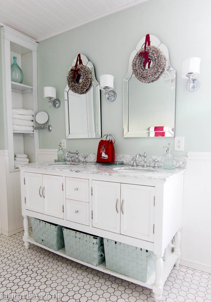 Holiday decor in master bathroom with arch mirrors, carrera marble and built ins