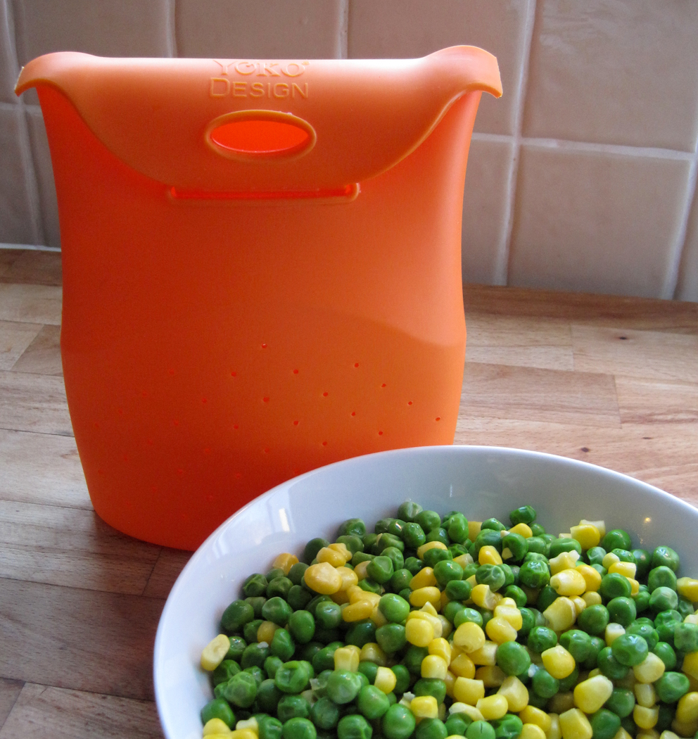 Silicone Vegetable Cooking Bag in bright orange
